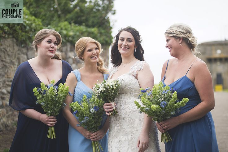 The bride & her bridesmaids about to walk down the outdoor aisle. Wedding in The Abbey Tavern, Howth. Photographed by Couple Photography.