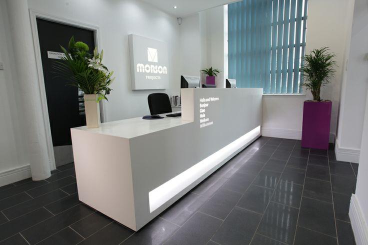 Mono Blok Reception Desk And Light Wall Company Logo For