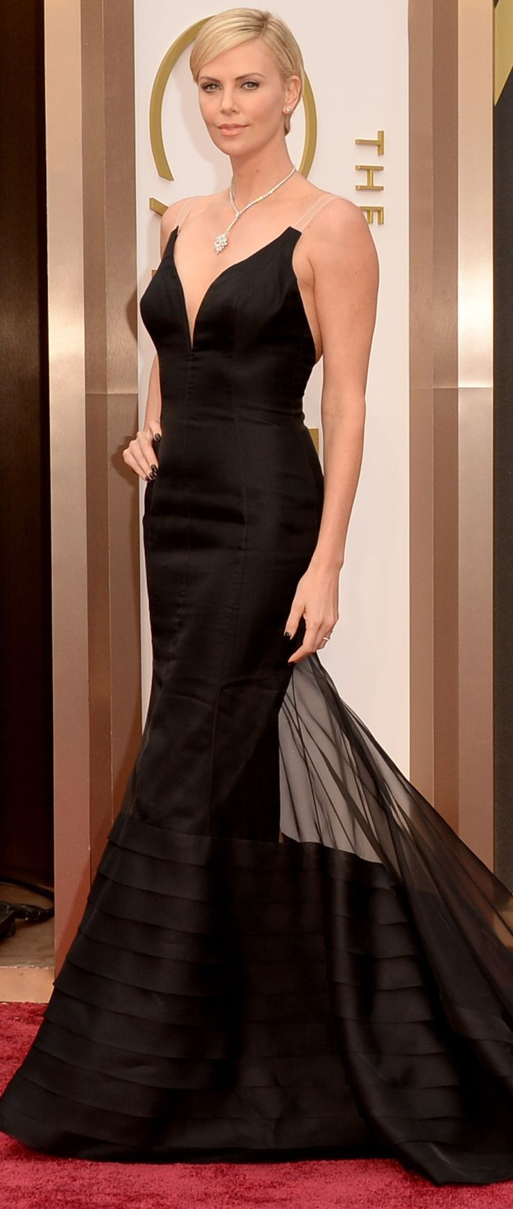 Charlize Theron in an elegant black Dior Haute Couture gown. #redcarpet #oscars