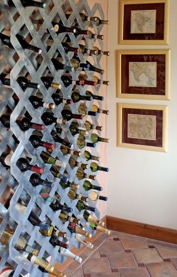 An entire foor to ceiling wine wall - Alex Davis sure knows the simple pleasures in life!