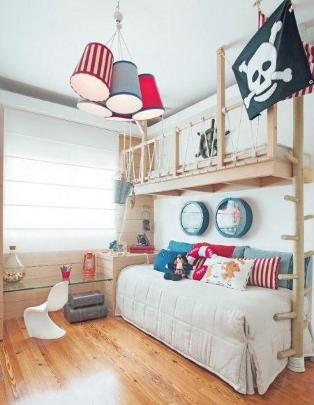 could add rope and knots to the existing bunk bed rails. like the lamp shades and adding the flag above the bunks. round picture frames = port holes