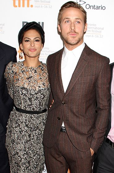 Eva Mendes and boyfriend Ryan Gosling smoldered together at the Toronto Film Festival. I love his suit and her dress.