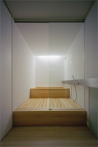 NB: built up structure using timber to cover any plumbing as well as creating levelled definition within a small space