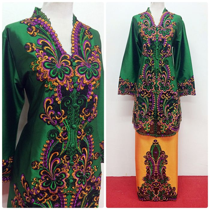 Loose-fitting kebaya in dark green colour with orangey bottom, rich with embroidery. Shop this kebaya at www.empireofelegance.com.my