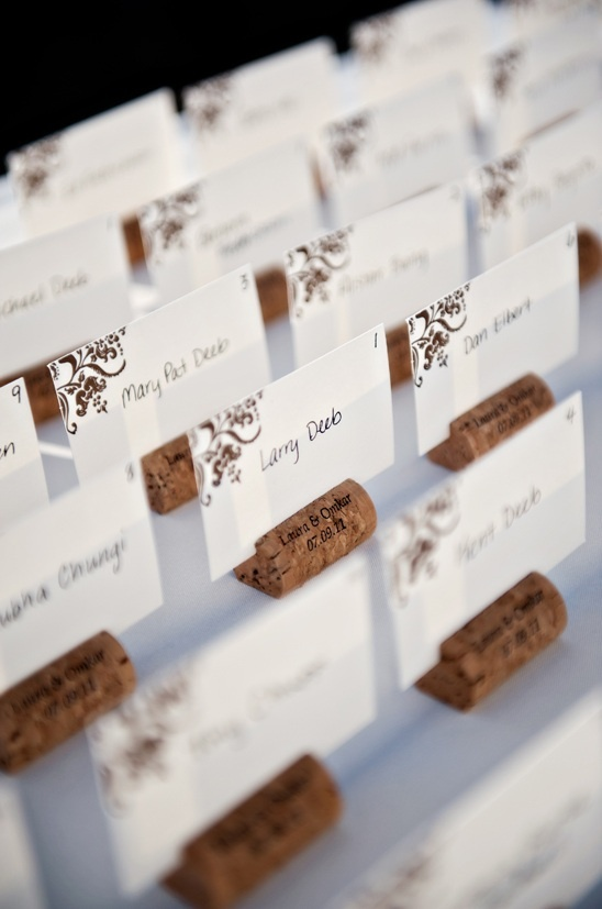 Cute personalized corks with a corner adorned place card.