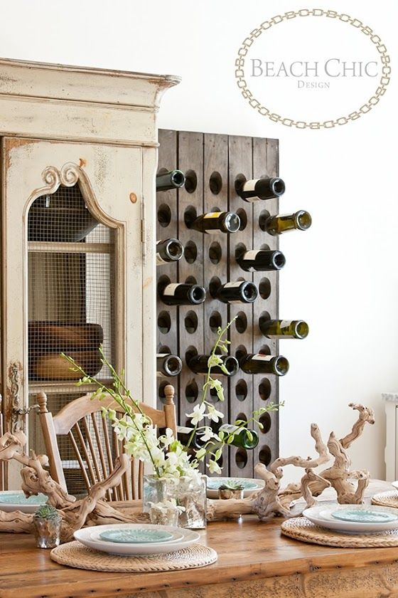 Use old champagne riddling racks mounted on the wall as wine racks
