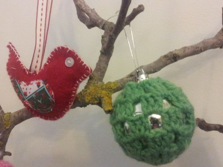 Felt is great to work with when making decorations.  the pattern for the crochet bauble was in the December 2012 Australian Women's Weekly.