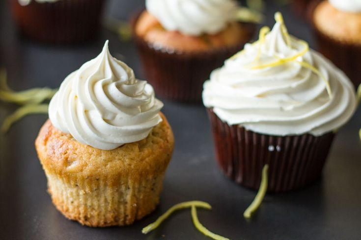 For the cupcakes:   	Preheat oven to 180* C (350* F) Fan. 	Combine the eggs, yogurt, sugar, vegetable oil and lemon zest in a bowl, using a hand whisk until the mixture is f...