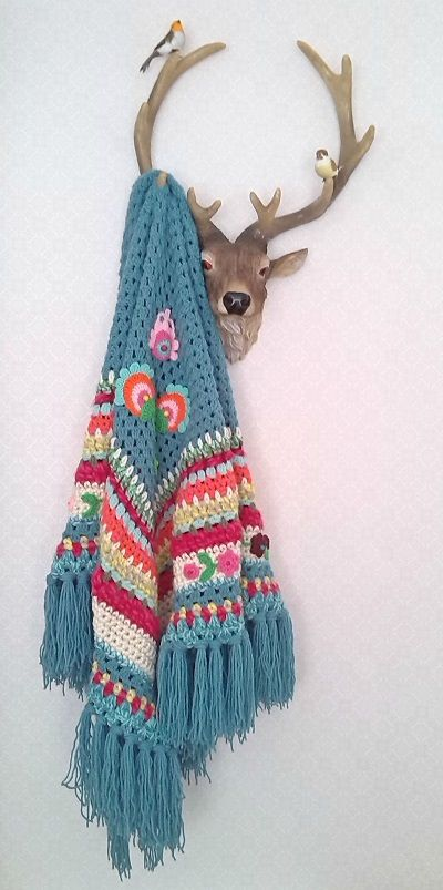 K maybe not with a realistic deer head, but I like this idea for displaying/storing a blanket