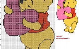Winnie the Pooh with heart cross stitch pattern