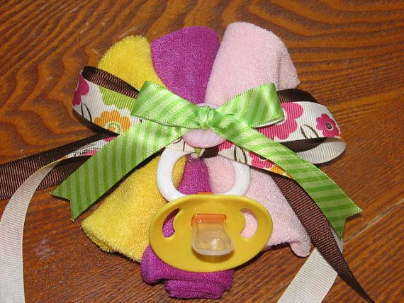 baby shower corsage in the theme colors with a theme appropriate