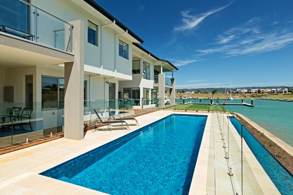 Set alongside the water at Martha Cove, Safety Beach Victoria, this classic lap pool design features a underground pool cover, surrounded by frameless pool glass fencing measures 12.0m x 3.0m.