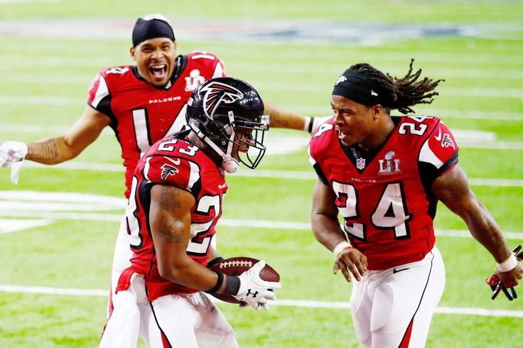Falcons fly after a TD:    Falcons teammates Eric Weems, left, and Devonta Freeman, right, celebrate with Robert Alford after he scored a touchdown on an 82‐yard interception return in the first half against the Patriots in Super Bowl 51 on Feb. 5 at NRG Stadium in Houston.