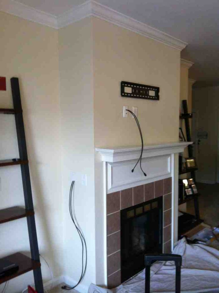 wall tv over above wiring t size mounted to wires hide components where full mounting brick of fireplace cords mount how on put