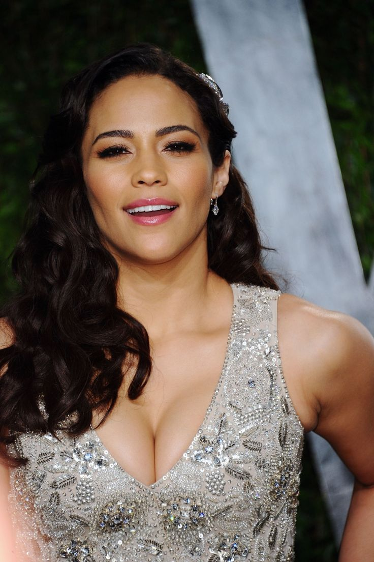 Paula Patton cleavage in a low cut silver gown
