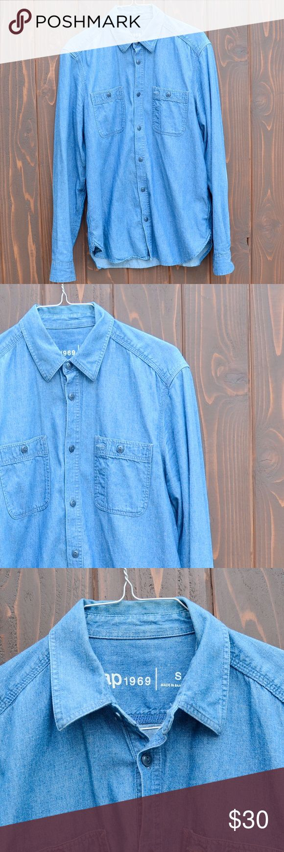 GAP Mens denim button down long sleeve shirt. GAP Mens denim button down long sleeve shirt. In good conditions with minor fading on the elbow area. Size Small in men's but may also fit a size medium. GAP Shirts Casual Button Down Shirts