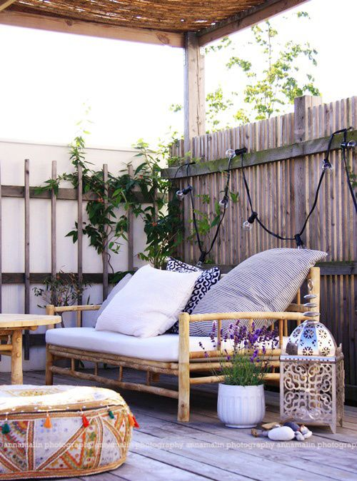 eclectic patio with beautiful exotic lanterns and floor pillows