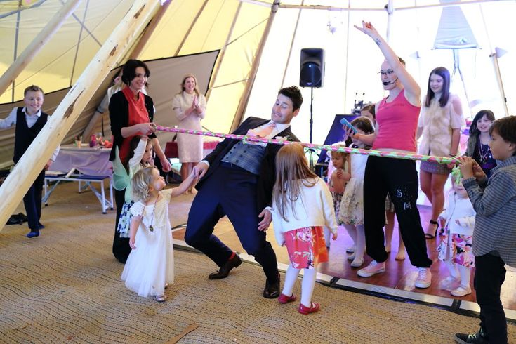 groom limbo dancing at fun family wedding celebrations tipi wedding essex