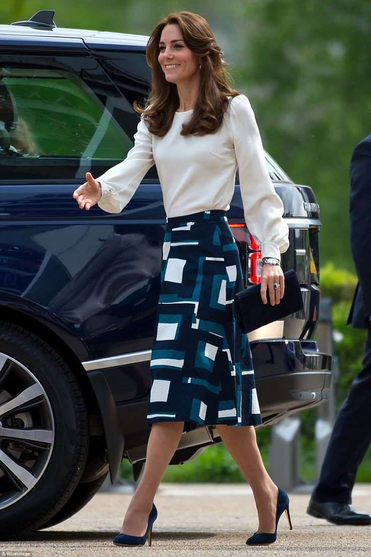 Kate looked glamorous in a white Goat blouse and a geometric print skirt from Banana Republic, which is now sold out