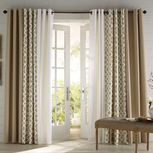 Two panels are not going to do it when it comes to hanging curtains. To have the right kind of fullness, be sure to make your curtains at least twice, or two and a half times, the size of your window, so that they gather nicely. Layering sheers with heavier fabrics is also a nice way to achieve a full look.