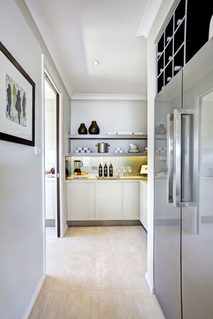 The Oasis Butler's Pantry is the perfect place to hide any unwanted mess or secret treats and delights. Punctuated with open shelving and slab under bench cabinets, you'll never run out of space. See the Oasis floor plans at http://www.mcdonaldjoneshomes.com.au/home-designs/queensland/oasis/floorplans #butlerspantry #butlerspantryideas #butlerspantryideaslayout #butlerspantriesmodern #kitchen #gourmetkitchen #storage #kitchenstorage #style #interiordesign #home #newhome  #mcdonaldjoneshomes