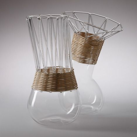 PANE E VINO BY ALBERTO FABBIAN AND PAOLA AMABILE by Harry / August 5, 2014  Traditional glass jugs in wicker baskets are reinterpreted and become jugs made of interwoven glass and wicker.
