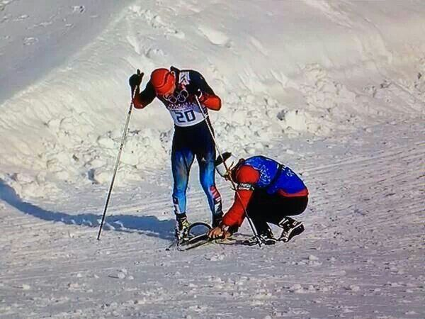 Canadian lending Russian skier a ski after his broke in a fall