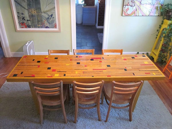 Hipcycle's Susan Tucker just may have found her dream table- an awesome dining room table made from  a gym floor!