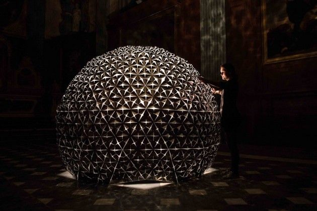 Artist Daan Roosegaarde created the Lotus Dome, an interactive sculpture made out of hundreds of ultra-light aluminum flowers that fold open in response to human behaviour.