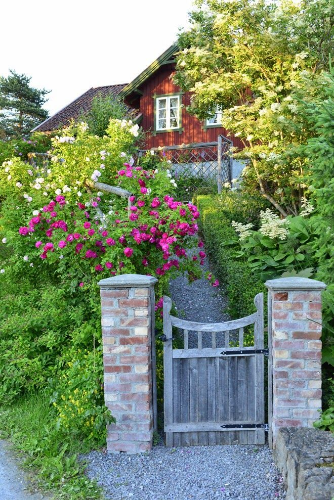 Interesting Pairing Of Wooden Gate With Stone Columns