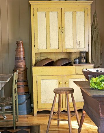 Yellow Cabinet       Red Wing bowls — an obsession of Berger's since he inherited his first from his grandmother — sit atop a cupboard, with original paint, acquired at a local antiques show.      Read more: Wisconsin Home Tour - Decorating a Farmhouse - Country Living