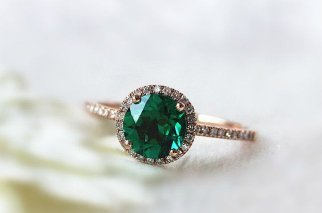 Round cut emerald, halo setting, pave band, rose gold // 24 Gorgeous Emerald Engagement Rings for the Alternative Bride via Brit + Co.