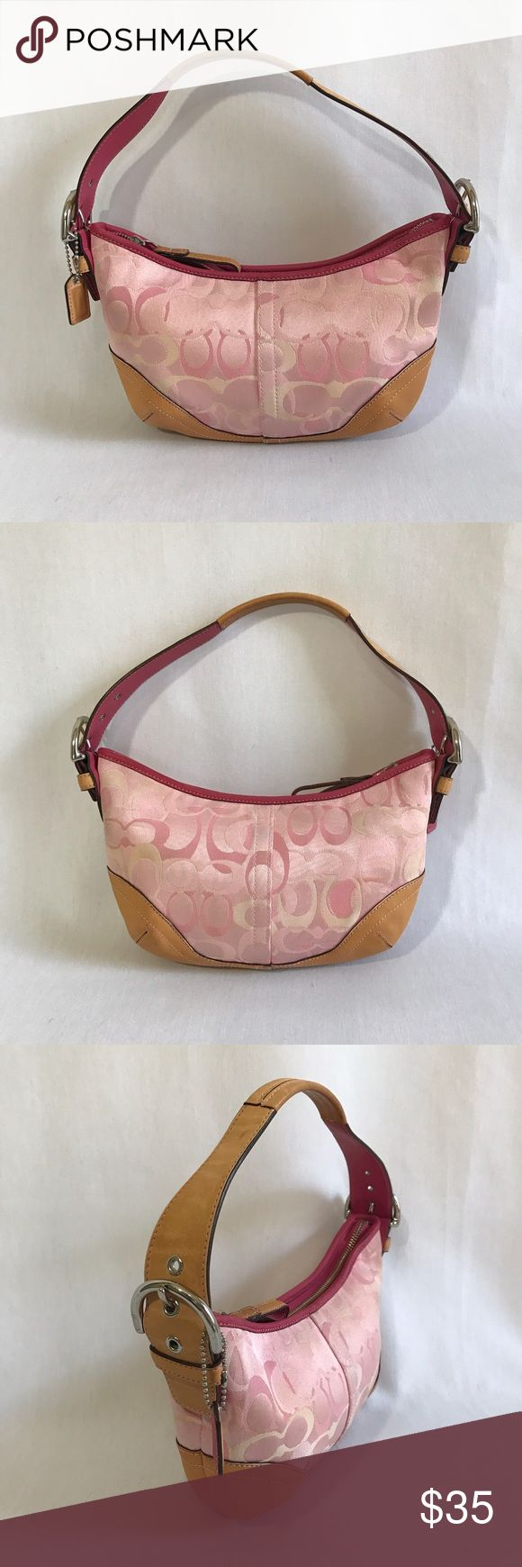 Coach Hobo Bag Pink opt art small hobo bag with tan leather trim and silver hardware. Pink lining with 1 zip pocket. Lining has slight marks (see picture). Zip closure. Great used condition. Coach Bags Hobos