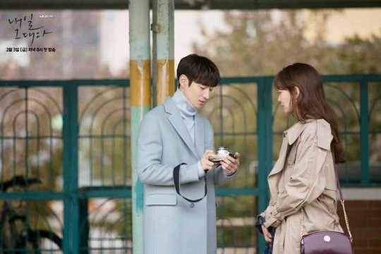 "The new Friday-Saturday drama from tvN, ""Tomorrow With You,"" has released some behind-the-scenes cuts from their main poster filming. ""Tomorrow With You"" w"