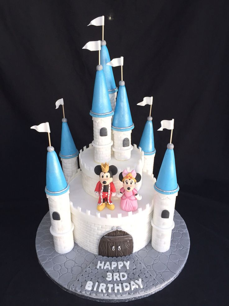 Disney castle cake with modelled Mickey and Minnie Mouse