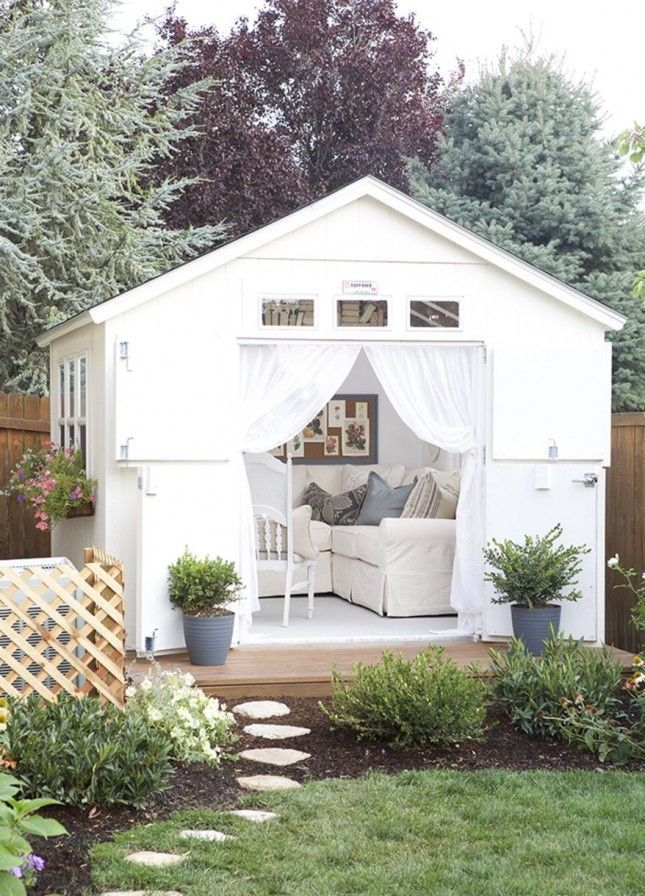 This charming she shed looks like it came straight out of a vacation catalogue, especially with the windows full of books.