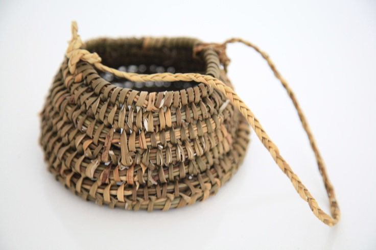 Woven basket made by Felicia Gonzalez one of the last 70 members of the Yaghan tribe, Puerto Williams, Isla Navarino, Cape Horn Province, Chile. Smoked rush reed (http://bit.ly/Imdc6L). H62mm, W/D125mm. http://bit.ly/HqrmJL.