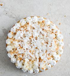 lemon cake with marshmallow frosting and toasted coconut.