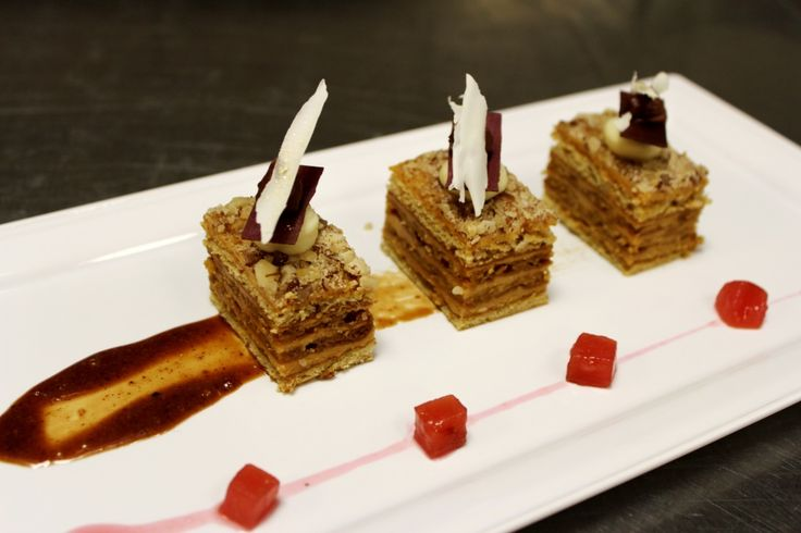 Honey cake with cinnamon cream, plum compote and nuts croccantino.