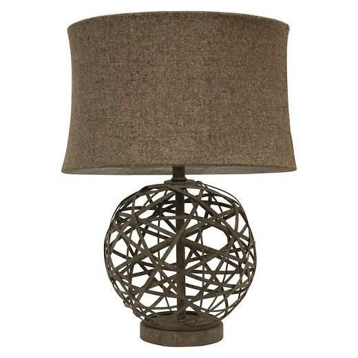 The contemporary design of the Strapped Steel Table Lamp from J. Hunt will make any space instantly brighter. The chic lamp features a durable steel base with a modern style and a rustic brown and grey finish. The grey lamp shade subdues the light so it doesn't overpower your space, whether it's a small den or large living room. The lamp can use up to a maximum 100 Watt lightbulb or 29 Watt CFL lightbulb. Not subject to California Title 20.