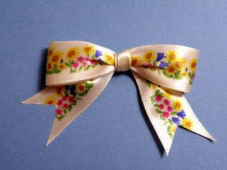 Tying one-sided ribbon into a bow.  I never could figure this out on my own.  Now I know.
