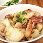 German Potato Salad--Yum! Added more bacon and used yellow onions sauteed with bacon instead of green onions. Definitely worth doing again.