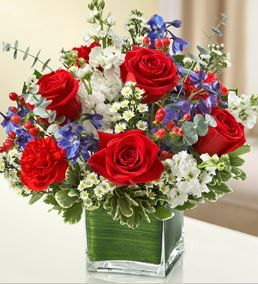 Healing Tears - Red, White and Blue Arrangement This lovely red, white and blue arrangement offers a beautiful reflection of your patriotism, love and support. Fresh red roses, delphinium, stock, carn