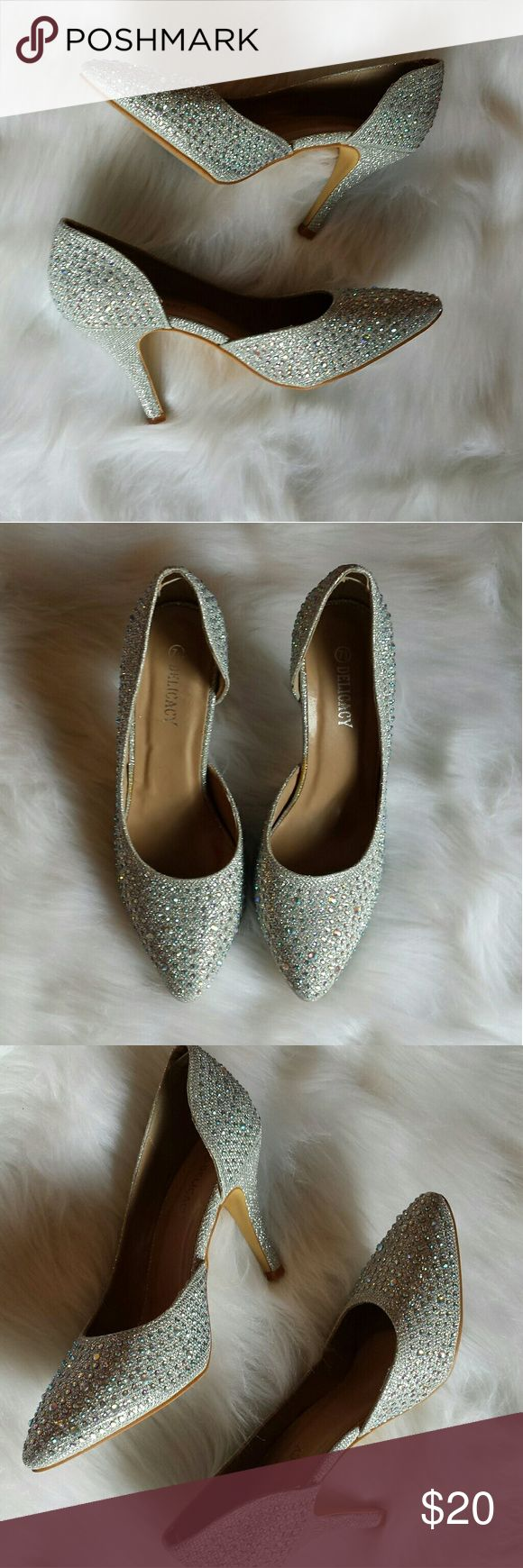 Like 🆕 Silver rhinestone heels Womens 7 1/2 kitten holographic heels. Used but in great condition. Nothing missing or broken. Yellow stain on the inside from the manufacturer's glue. Silver with holographic gems. Pictures don't do it justice! Delicacy Shoes Heels
