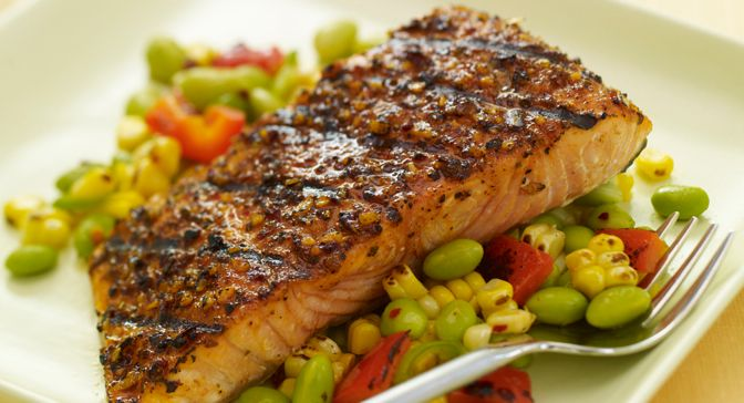 Contemporize the classic succotash with heat from ancho chile pepper, and edamame and grilled corn kernels. Serve as an accompaniment to salmon crusted with a sweet-heat seasoning rub.