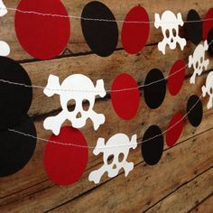 Aye Matey! A perfect Pirate Party Skull garland! Hand punched and sewn together with white thread. Thread left on the ends for tying/hanging.