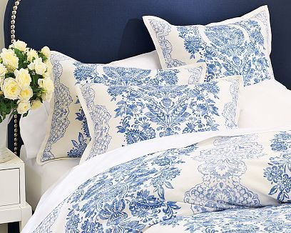 Navy blue and white bed linens - reminiscent of the blue and white china I love collecting!