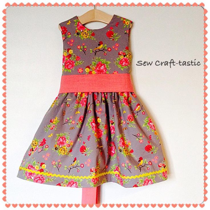 Vintage grey floral and birds print party dress. Yellow trim and coral sash. Hand covered matching buttons.