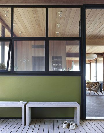 Painted cement board panels were inspired by Charles and Ray Eames's midcentury house in Pacific Palisades, California. The color was chosen by architectural color consultant Eve Ashcraft, who used #7495 by Fine Paints of Europe.