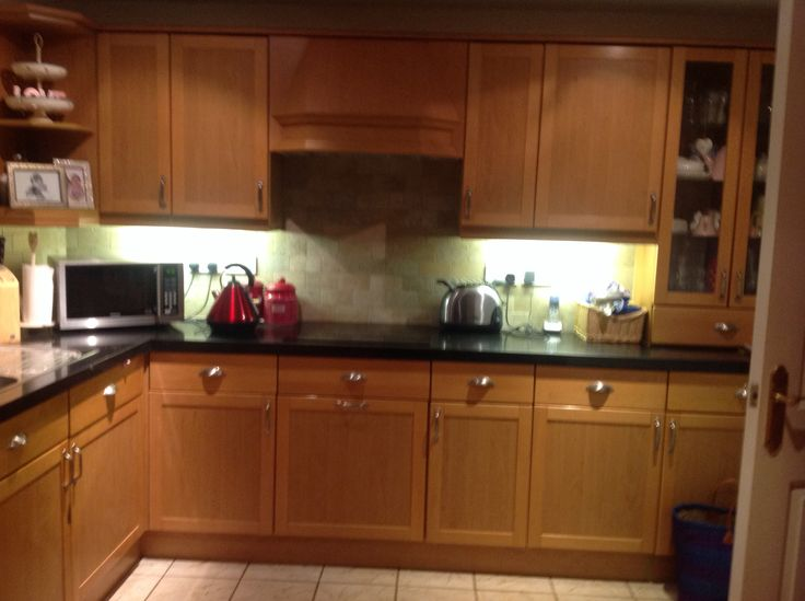 Black granite worktop and stone effect tiles